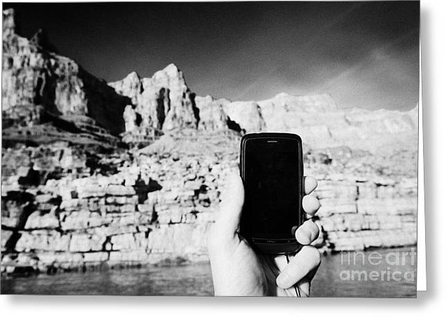 Cellphone Greeting Cards - man taking photos with smartphone during boat ride along the colorado river in the grand canyon Ariz Greeting Card by Joe Fox