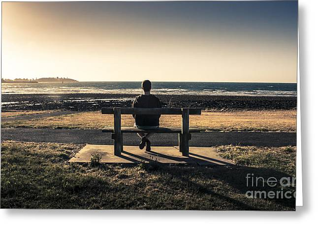 Park Benches Greeting Cards - Man watching Australian sunset on park bench Greeting Card by Ryan Jorgensen