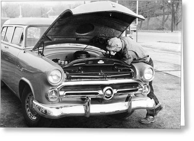 Dexterity Greeting Cards - Man Working On HIs Car Greeting Card by Underwood Archives