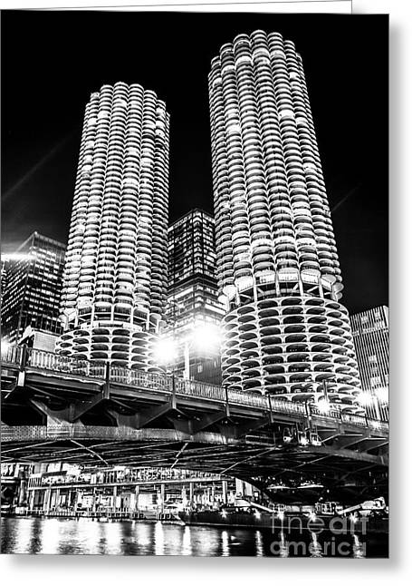 Glowing Water Greeting Cards - Marina City Towers at Night Black and White Picture Greeting Card by Paul Velgos