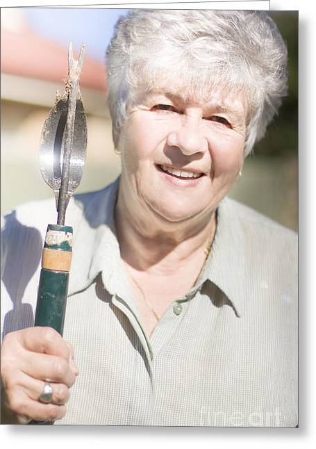 Gray Hair Greeting Cards - Mature Woman With Garden Tool Greeting Card by Ryan Jorgensen