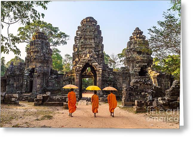 Real People Greeting Cards - Monks with umbrella walking into Angkor Wat temple - Cambodia Greeting Card by Matteo Colombo