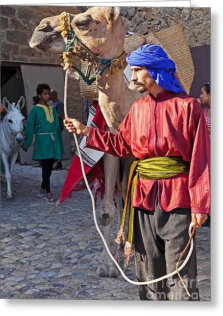 Historical Re-enactments Greeting Cards - Moorish man with dromedary  Greeting Card by Jose Elias - Sofia Pereira