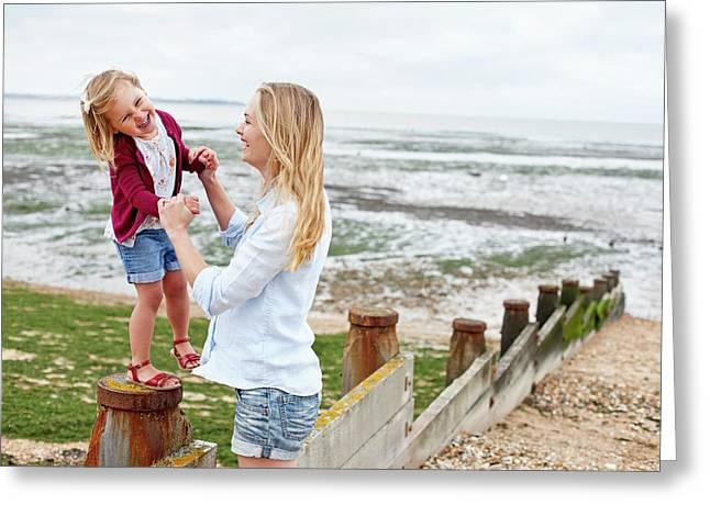 Mother With Daughter On Beach Greeting Card by Ian Hooton