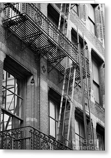 Manhaten Greeting Cards - Old Metal Fire Escape Staircase On Side Of Building Greenwich Village New York City Greeting Card by Joe Fox
