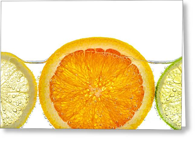 Juicy Greeting Cards - Orange lemon and lime slices in water Greeting Card by Elena Elisseeva