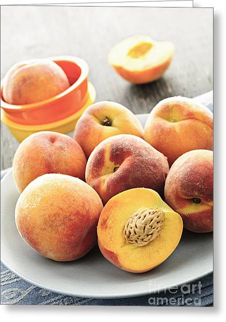 Slices Greeting Cards - Peaches on plate Greeting Card by Elena Elisseeva