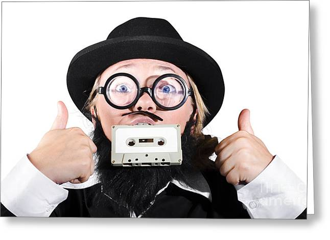 Cassettes Greeting Cards - Person Holding Cassette In Mouth With Showing Thumb Up Sign Greeting Card by Ryan Jorgensen