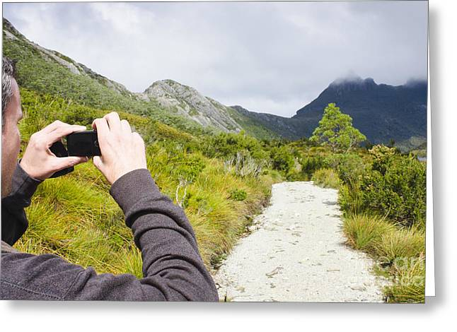 Cradle-mountain Greeting Cards - Person on expedition tour of Cradle Mountain Greeting Card by Ryan Jorgensen