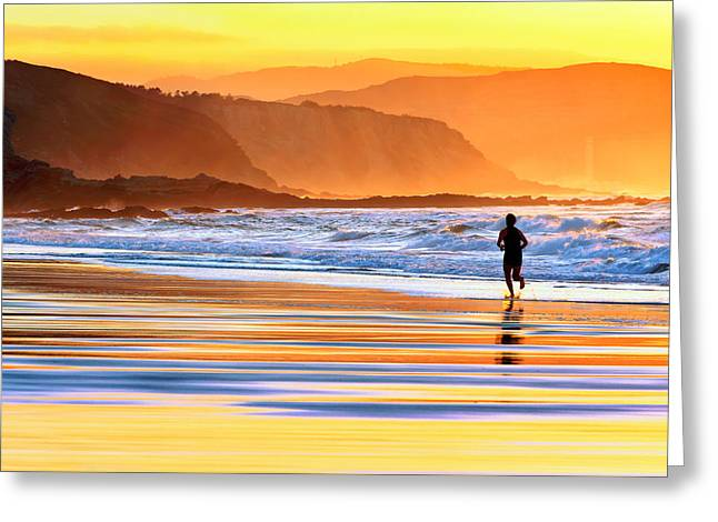 Pais Vasco Greeting Cards - Person Running On Beach At Sunset Greeting Card by Mikel Martinez de Osaba