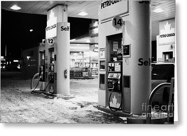 petro canada winter gas fuel pump at service station Regina Saskatchewan Canada Greeting Card by Joe Fox