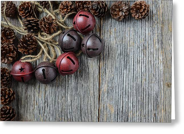 Pine Cones Greeting Cards - Pine cones and Rustic Bells on an Old Wood Background Greeting Card by Brandon Bourdages
