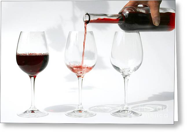 pouring red wine into glass Greeting Card by Patricia Hofmeester