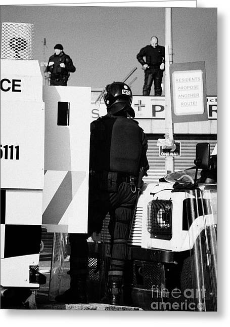 Protest Greeting Cards - PSNI officers in protective riot gear at landrovers and snipers on crumlin road at ardoyne shops bel Greeting Card by Joe Fox