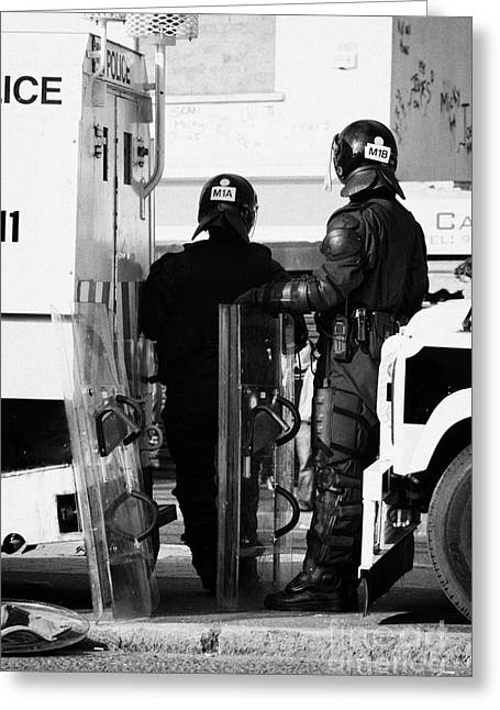 Protest Greeting Cards - PSNI officers in protective riot gear at landrovers on crumlin road at ardoyne shops belfast 12th Ju Greeting Card by Joe Fox