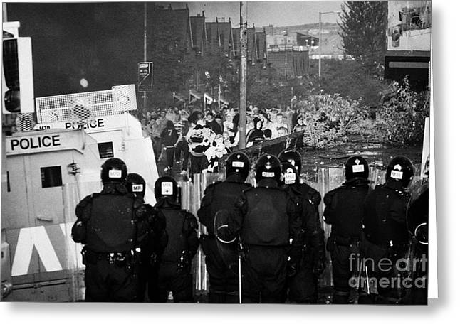 Terrorist Greeting Cards - PSNI riot officers face rioters mob on crumlin road at ardoyne shops belfast 12th July Greeting Card by Joe Fox