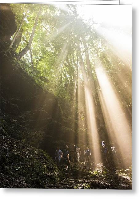 Sink Hole Greeting Cards - Rays Of Sunlight Shining Down On Hikers  Greeting Card by Joel Harrison