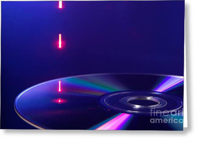 Laser Beam Greeting Cards - Reading Dvd Greeting Card by GIPhotoStock