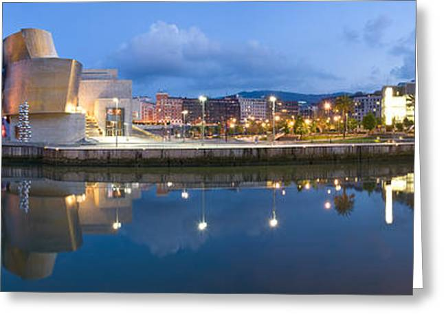 Guggenheim Greeting Cards - Reflection Of A Museum On Water Greeting Card by Panoramic Images