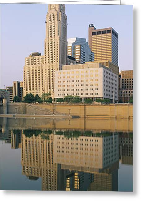 Reflection Of Buildings In A River Greeting Card by Panoramic Images