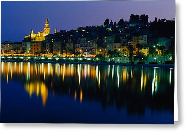 Reflection Of Buildings In Water Greeting Card by Panoramic Images