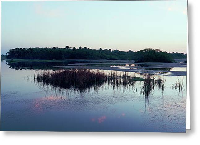 Reflection Of Clouds In Water Greeting Card by Panoramic Images