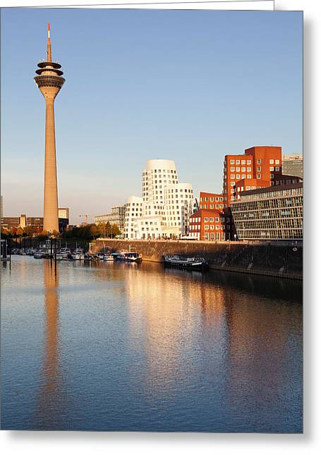 Communications Tower Greeting Cards - Rheinturm Tower And Neuer Zollhof Greeting Card by Panoramic Images
