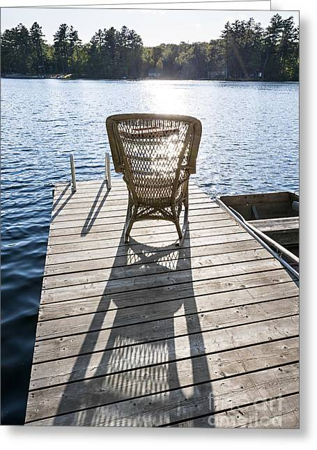 Rockers Greeting Cards - Rocking chair on dock Greeting Card by Elena Elisseeva
