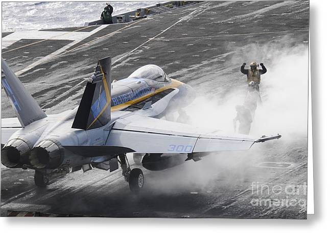 Military Airplanes Greeting Cards - Sailors Prepare An Fa-18c Hornet Greeting Card by Stocktrek Images