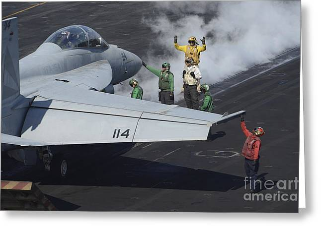 Military Airplanes Greeting Cards - Sailors Prepare An Fa-18f Super Hornet Greeting Card by Stocktrek Images
