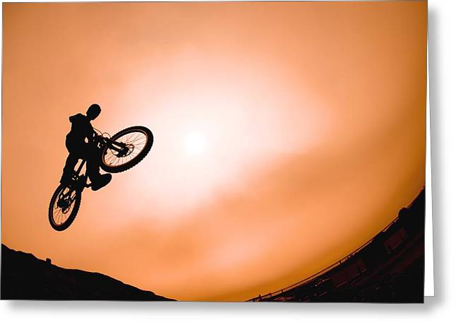 Silhouette Of Stunt Cyclist Greeting Card by Corey Hochachka