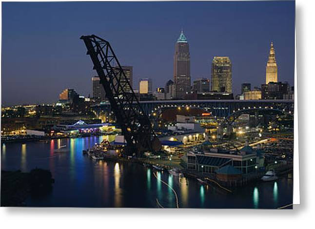 Drawbridge Greeting Cards - Skyscrapers Lit Up At Night In A City Greeting Card by Panoramic Images