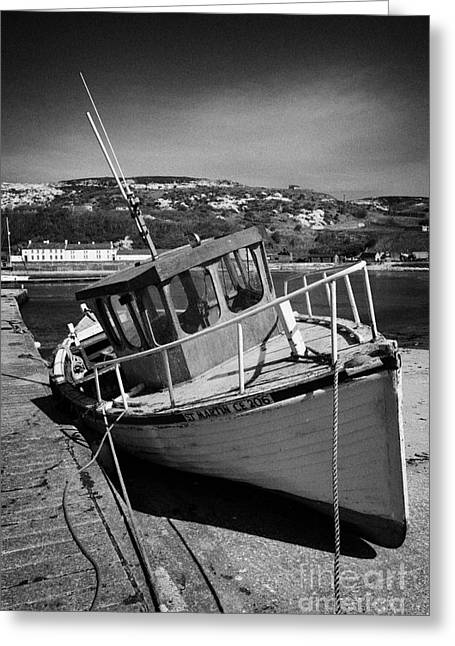Tie-break Greeting Cards - Small Fishing Boat Lying High And Dry In Church Bay Rathlin Harbour Rathlin Island Northern Ireland Greeting Card by Joe Fox
