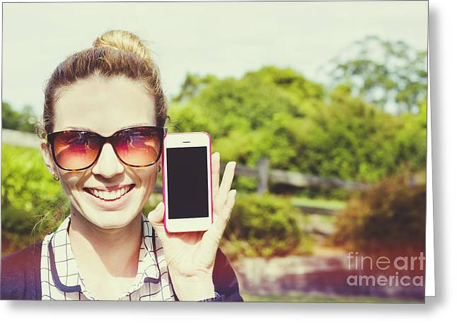 Cellphone Greeting Cards - Smiling person showing cell phone handset   Greeting Card by Ryan Jorgensen