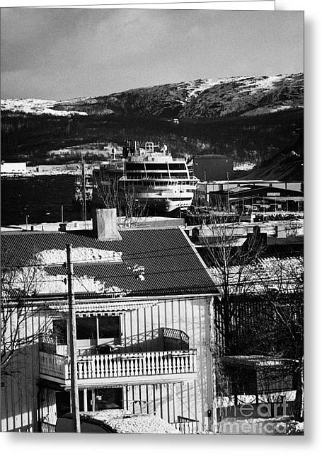Snow Covered Street Greeting Cards - Snow Covered Street Of Traditional Wooden Houses Looking Down To Hurtigruten Ship In Kirkenes Harbou Greeting Card by Joe Fox