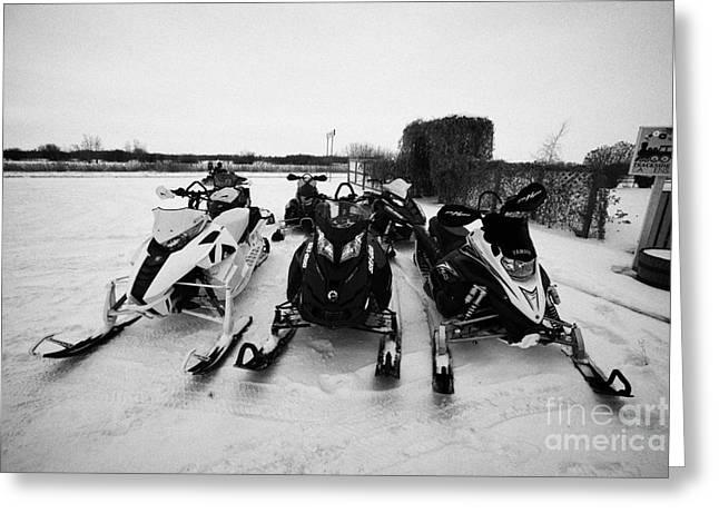 snowmobiles parked in Kamsack Saskatchewan Canada Greeting Card by Joe Fox