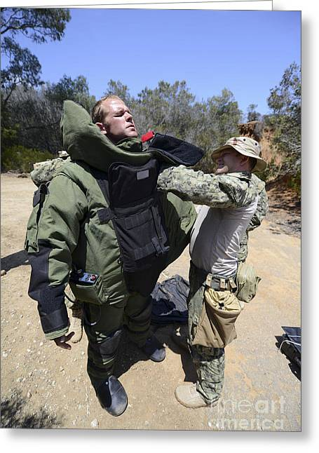 Cooperation Greeting Cards - Soldier Provides Assistance In Putting Greeting Card by Stocktrek Images