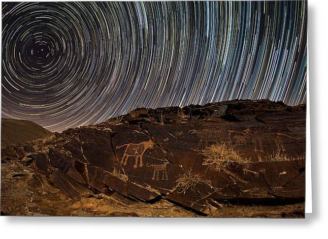 Star Trails Over Rock Carvings Greeting Card by Babak Tafreshi