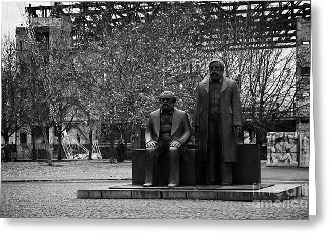 Berlin Germany Greeting Cards - statues of marx and engels with deconstruction of the palast der republik in the background Berlin Germany Greeting Card by Joe Fox