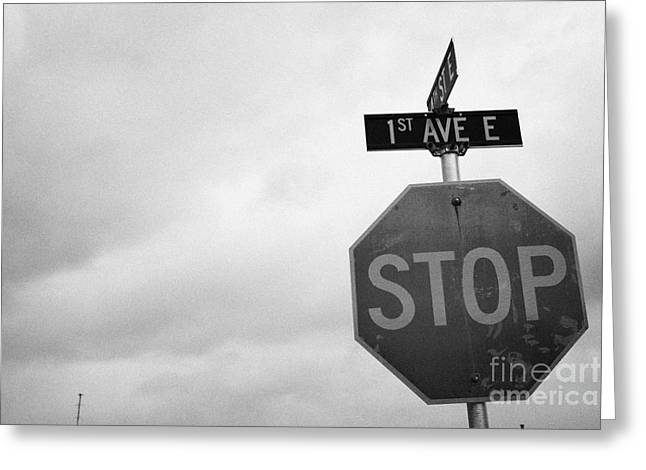 Overcast Day Greeting Cards - stop sign at junction of first street and first avenue on a cold grey day assiniboia Saskatchewan Ca Greeting Card by Joe Fox