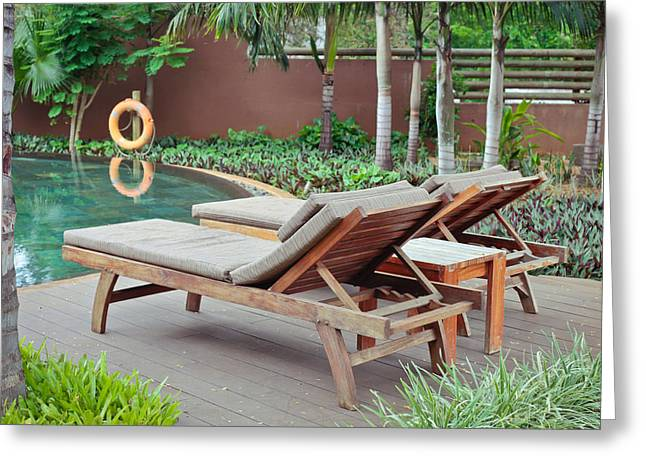 Deck-chair Greeting Cards - Sunloungers Greeting Card by Tom Gowanlock