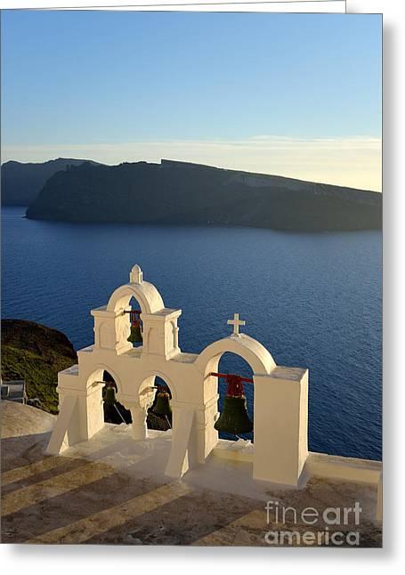 Sunset Behind A Belfry In Santorini Island Greeting Card by George Atsametakis