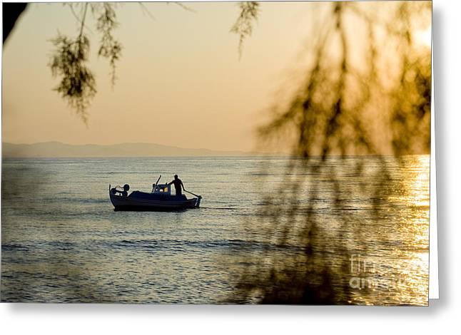 Sunset Prints Greeting Cards - Sunset boat at sea Greeting Card by Raimond Klavins