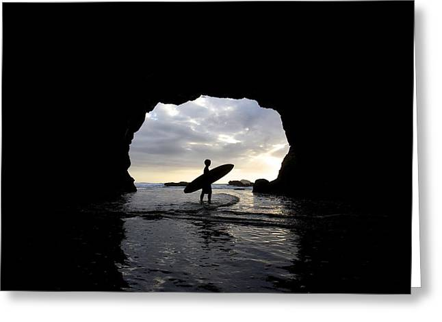 Surf Silhouette Greeting Cards - Surfer Inside A Cave At Muriwai New Greeting Card by Deddeda