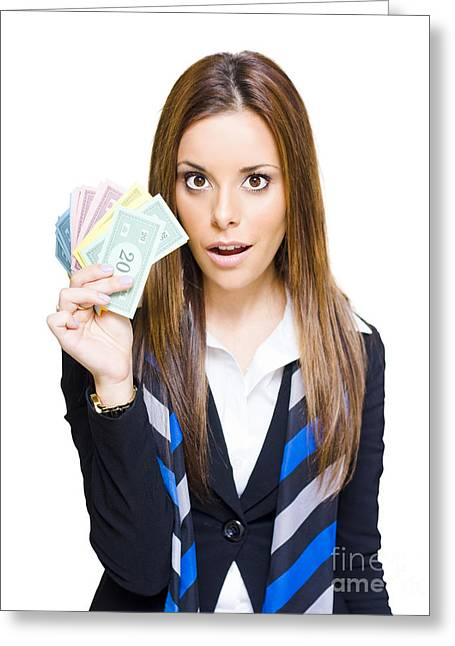 Monopoly Greeting Cards - Surprised Young Business Woman Holding Fan Of Money Greeting Card by Ryan Jorgensen