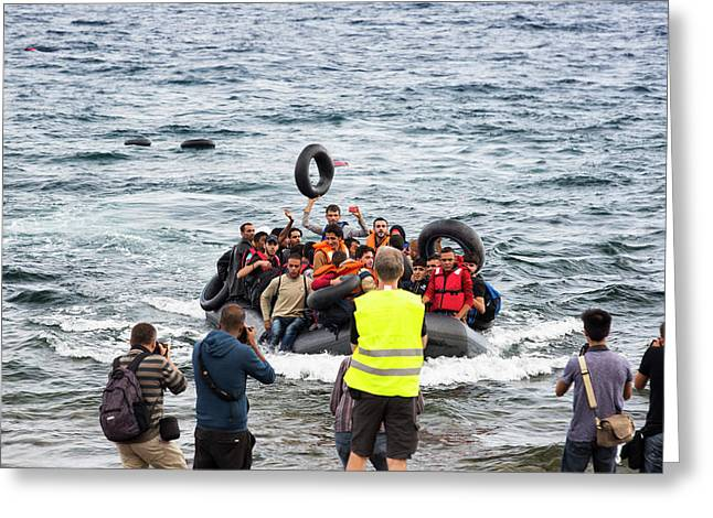 Syrian Refugees Arriving On Greek Island Greeting Card by Ashley Cooper