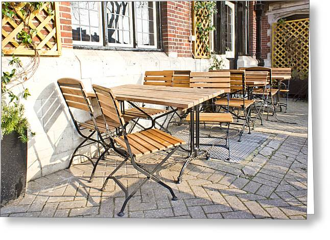 European Restaurant Greeting Cards - Tables and chairs Greeting Card by Tom Gowanlock