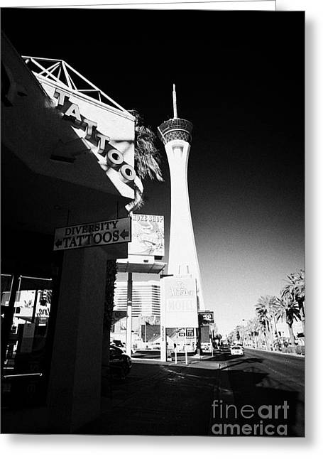 Stratosphere Greeting Cards - tattoo parlour near the statosphere hotel tower and casino Las Vegas Nevada USA Greeting Card by Joe Fox