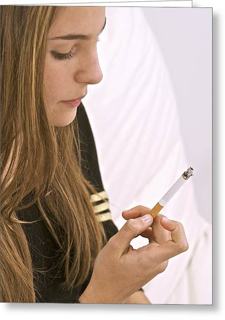 Carcinogenic Greeting Cards - Teenager smoking Greeting Card by Science Photo Library