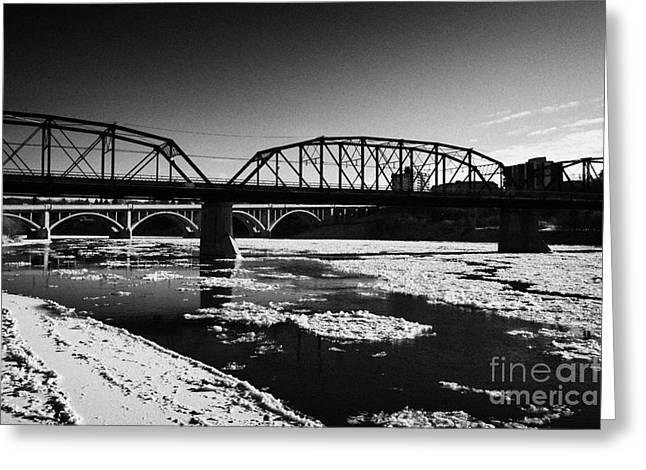 Old North Bridge Greeting Cards - The Old Traffic And Broadway Bridges Over The South Saskatchewan River In Winter Flowing Through Dow Greeting Card by Joe Fox